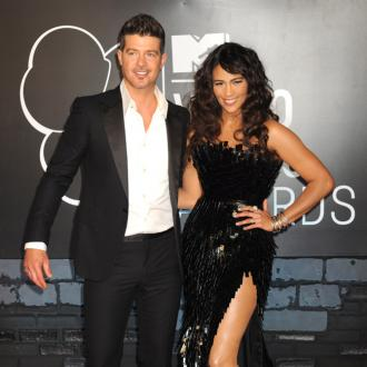 Robin Thicke Dances With Mystery Woman