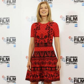 Rosamund Pike 'Barely Spoke' To Christian Bale