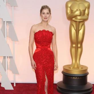 Rosamund Pike has almost regained her six-pack