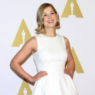 Rosamund Pike 'close to six-pack' three months after giving birth
