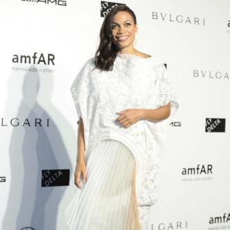 Rosario Dawson ditches clothes in summer