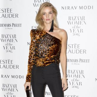 Rosie Huntington-Whiteley does cartwheels when she sees people in her designs