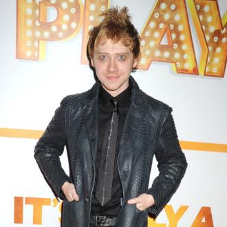 Rupert Grint wears a hat to hide his identity