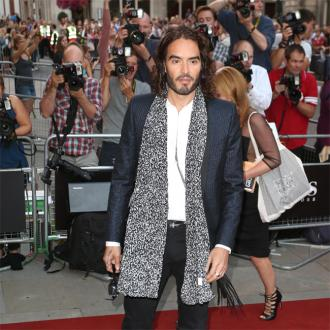 Russell Brand reading parenting books