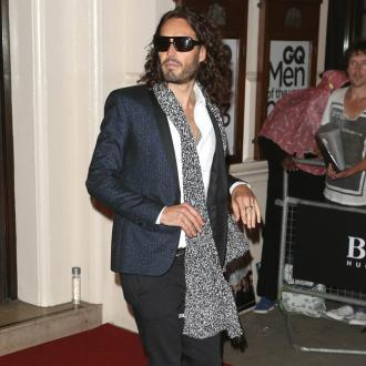 Russell Brand serenades dog before operation
