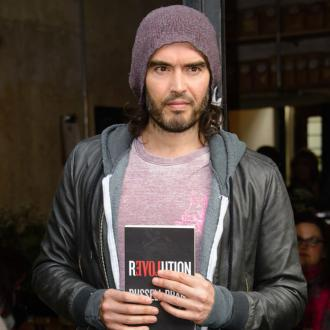 Russell Brand building security fence