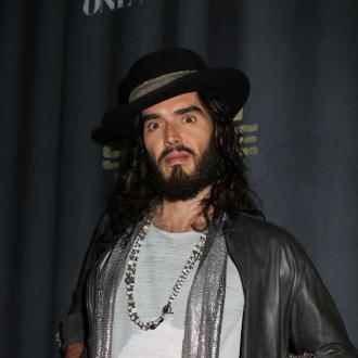 Russell Brand Ambushed By Tattooed Tackle