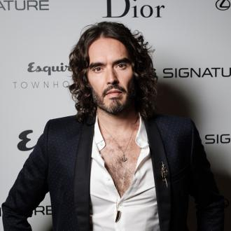 Russell Brand feels 'more relaxed' around 'junkies