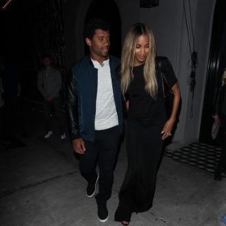 Russell Wilson designs Nike trainers for unborn baby