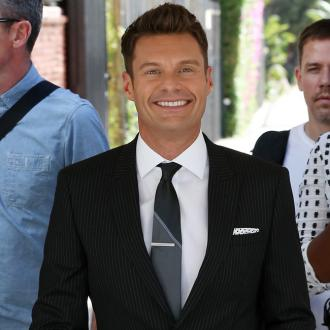 Ryan Seacrest gets stuck in a lift