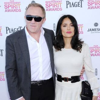 Salma Hayek wears leather for her husband
