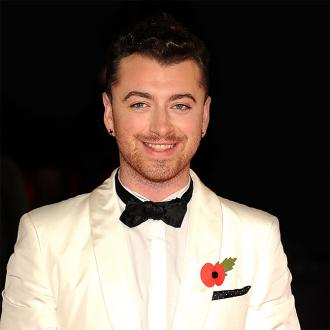 Sam Smith is 'a bit behind' in relationships