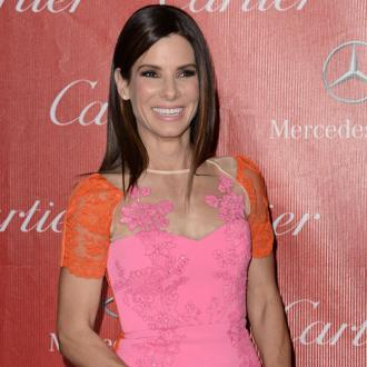 Sandra Bullock Jokes About Chris Evan's Romance