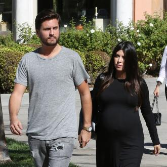 Kourtney Kardashian Hints At Scott Disick Split
