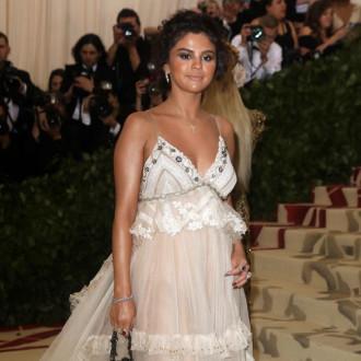 Selena Gomez laughs of 2018 Met Gala tanning disaster