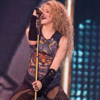 Shakira is 'never entirely satisfied' with her own songs