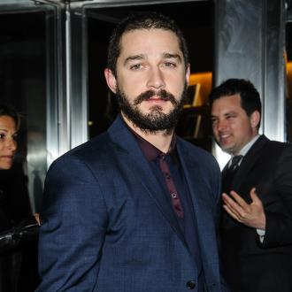 Shia Labeouf Wears Brown Paper Bag To Premiere
