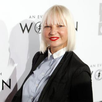 Sia understands white privilege through adopted sons