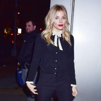 Sienna Miller loves wearing 'masculine workman's clothes'