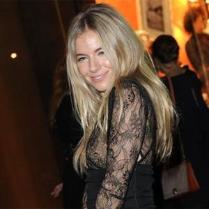 Sienna Miller Donates Shoes To Charity