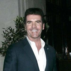 Simon Cowell Makes Time For Love