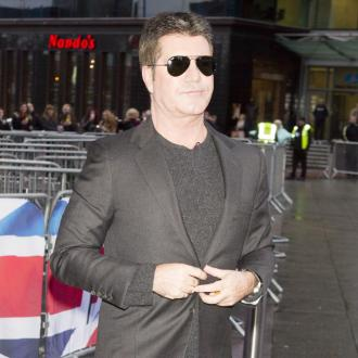 Simon Cowell Takes Up Vaping In Bid To Quit Smoking