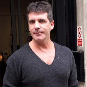 Simon Cowell Upset By Cheryl Cole Rift