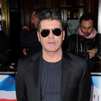 Simon Cowell apologises after making gay joke