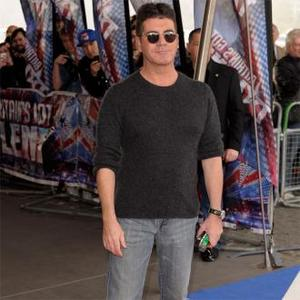 Simon Cowell Has Crush On New Make-up Artist