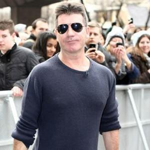 Simon Cowell 'Was Engaged To Glamour Model'