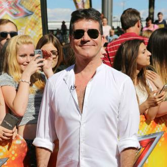 Simon Cowell's son Eric 'shares his charm'