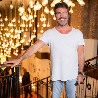 Simon Cowell donates 100k to fire victims
