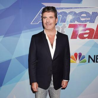 Simon Cowell taken to hospital following fall at London home