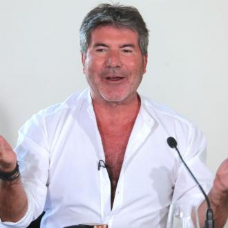 Simon Cowell gives Eric control of Syco