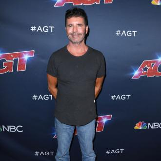 Simon Cowell Jokes About 'Workout Video'
