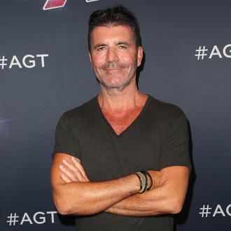Simon Cowell happy for Kelly Clarkson