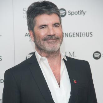 Simon Cowell is on the mend after breaking his back: 'He's taken some steps'