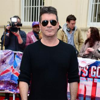 Simon Cowell To Buy Robot Body?