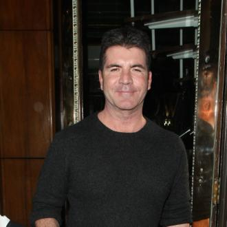 Simon Cowell 'Dumped Lauren Weeks Ago'