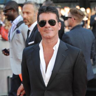Simon Cowell Already Good At Playing Dad