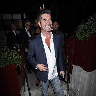 Simon Cowell To Build Smoking Room When Baby's Born