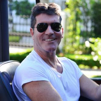 Simon Cowell Wants His Son To Work For Success