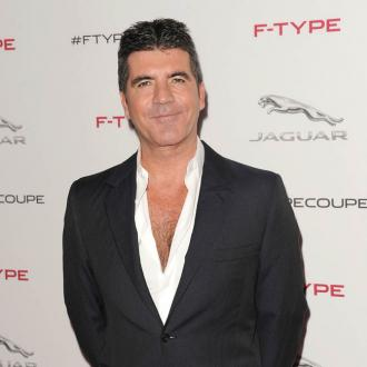 Simon Cowell To Quit Smoking In Front Of Son