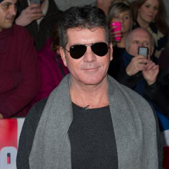 Simon Cowell Won't Change Nappies
