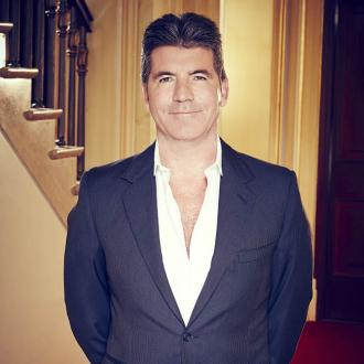 Simon Cowell gets told off by mum