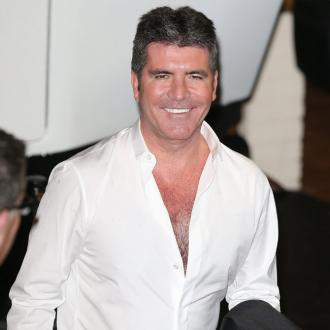 Simon Cowell son annoys 'grumpy' man on flight