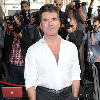 Simon Cowell: Son will bark before he talks
