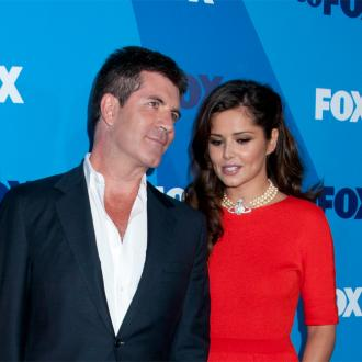 Simon Cowell Is 'Close' With Cheryl