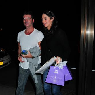 Simon Cowell And Lauren Silverman Have 'Trust Issues'?
