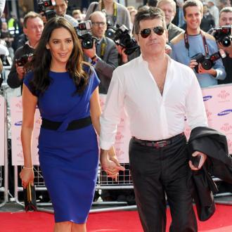 Simon Cowell's Son Thinks He's A Dog